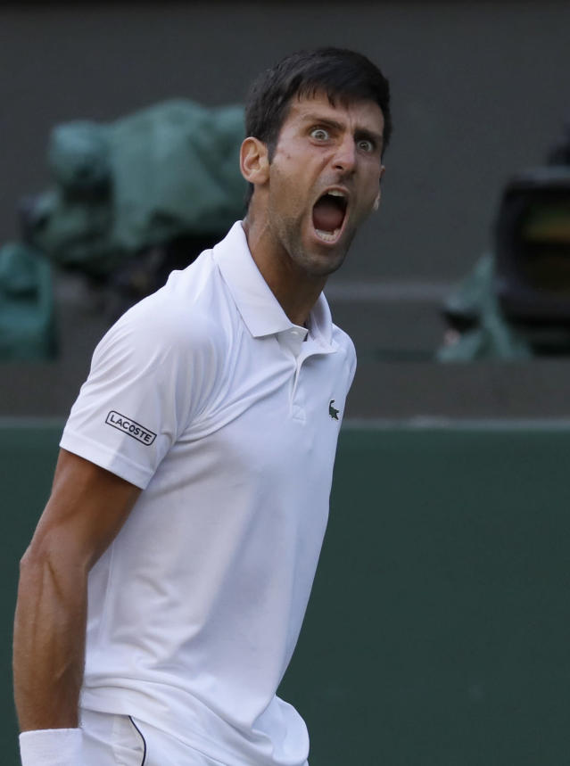 Serbia's Novak Djokovic celebrates winning the point before match point during his men's singles match against Kyle Edmund of Great Britain, on the sixth day of the Wimbledon Tennis Championships in London, Saturday July 7, 2018. (AP Photo/Kirsty Wigglesworth)