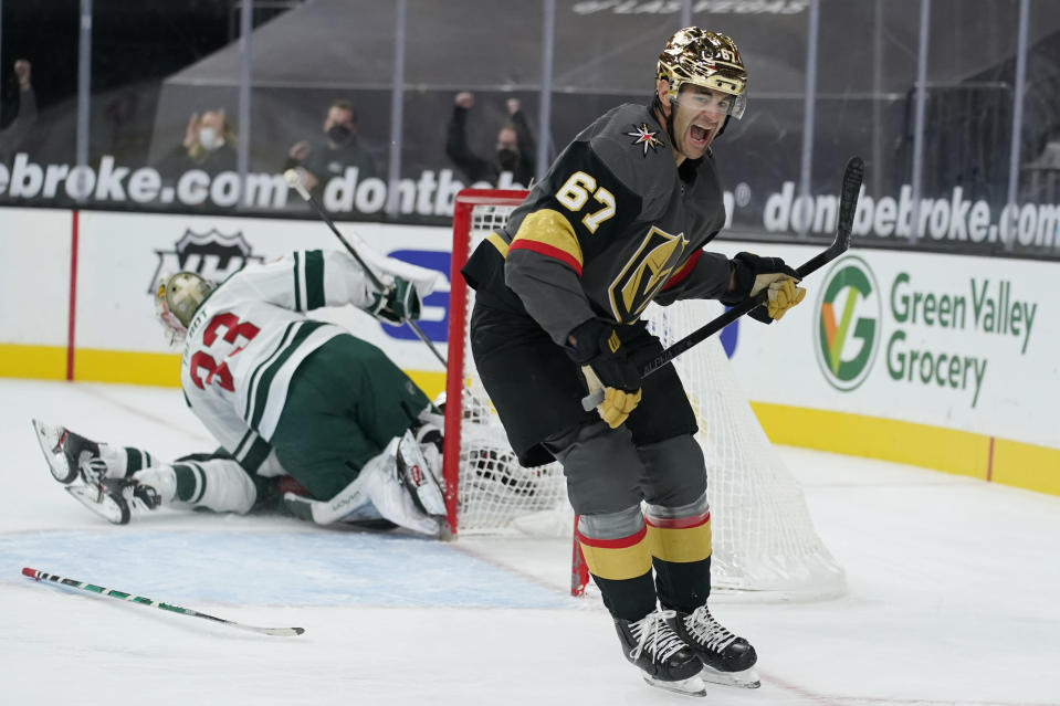 Vegas Golden Knights left wing Max Pacioretty (67) celebrates after scoring against Minnesota Wild goaltender Cam Talbot (33) during overtime of an NHL hockey game Monday, March 1, 2021, in Las Vegas. (AP Photo/John Locher)