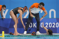 Netherlands head coach Arno Havenga congratulates his players after a 33-1 win over South Africa in a preliminary round women's water polo match at the 2020 Summer Olympics, Friday, July 30, 2021, in Tokyo, Japan. (AP Photo/Mark Humphrey)