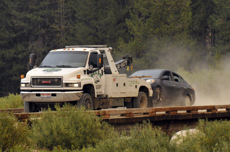 James Dimaggio's car is towed to the town of Cascade after dectives finished searsching it on a trail head bordering the Frank Church River of No Return Wilderness on Saturday, Aug. 10, 2013. Dimaggio, 40, is suspected of killing a California woman and her young son and then fleeing with the 16-year-old daughter was found in the Idaho wilderness on Friday after horseback riders reported seeing the man and girl hiking in the area two days earlier, authorities said. (AP Photo/Robby Milo)