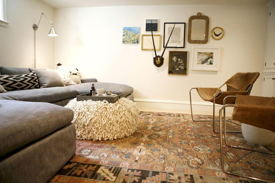 """<p>Bring modern boho style to your basement with a vintage (or vintage-inspired) rug and a textured ottoman. This look feels lived-in—in the best possible way! </p><p><strong>See more at <a href=""""https://www.katiehackworth.com/blog/domaine-feature-basement-reveal"""" rel=""""nofollow noopener"""" target=""""_blank"""" data-ylk=""""slk:Katie Hackworth"""" class=""""link rapid-noclick-resp"""">Katie Hackworth</a>. </strong></p><p><a class=""""link rapid-noclick-resp"""" href=""""https://go.redirectingat.com?id=74968X1596630&url=https%3A%2F%2Fwww.walmart.com%2Fip%2FWell-Woven-Talya-Heriz-Oriental-Medallion-Vintage-Red-Area-Rug-3x5-3-11-x-5-3%2F341856219&sref=https%3A%2F%2Fwww.redbookmag.com%2Fhome%2Fg36061437%2Fbasement-ideas%2F"""" rel=""""nofollow noopener"""" target=""""_blank"""" data-ylk=""""slk:SHOP RUGS"""">SHOP RUGS</a></p>"""