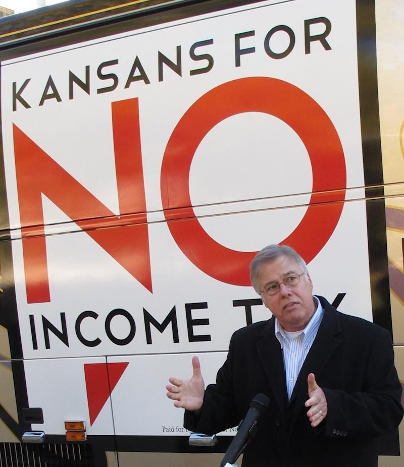 Kansas state Rep. Joe Patton, a Topeka Republican, talks about proposals to eliminate the state's income tax during a news conference, Friday, Nov. 4, 2011, outside the Statehouse in Topeka, Kan. Patton favors the idea, seeing it as a way to promote economic growth.  (AP Photo/John Hanna)