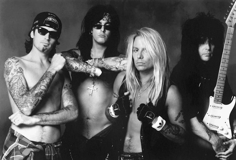 Tommy Lee, left, Nikki Sixx, Vince Neil and Mick Mars of rock group Motley Crue.