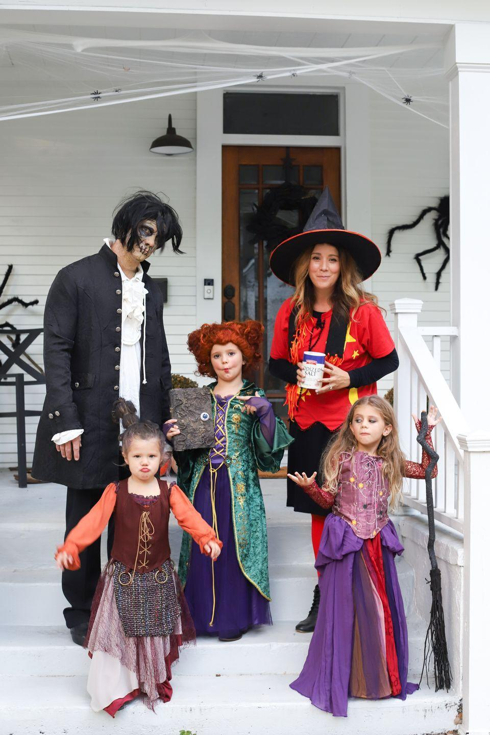 """<p>No curses will be necessary to make everyone you encounter fall under the spell of Winifred, Sarah, and Mary Sanderson with these adorable looks. Round out the group with Billy and Dani—and don't forget the <a href=""""https://www.amazon.com/Morton-Salt-26-oz/dp/B000Q3E8EA/ref=dp_prsubs_2?pd_rd_i=B08F6YV5MY&psc=1&tag=syn-yahoo-20&ascsubtag=%5Bartid%7C10050.g.29074815%5Bsrc%7Cyahoo-us"""" rel=""""nofollow noopener"""" target=""""_blank"""" data-ylk=""""slk:salt"""" class=""""link rapid-noclick-resp"""">salt</a>! </p><p><strong>Get the full tutorial at <a href=""""https://www.thegrayruby.com/hocus-pocus-family-halloween-costume/"""" rel=""""nofollow noopener"""" target=""""_blank"""" data-ylk=""""slk:The Gray Ruby"""" class=""""link rapid-noclick-resp"""">The Gray Ruby</a>. </strong></p><p><a class=""""link rapid-noclick-resp"""" href=""""https://www.amazon.com/Onene-Halloween-Broomstick-Realistic-Accessory/dp/B07Y46SX28/ref=sr_1_5?tag=syn-yahoo-20&ascsubtag=%5Bartid%7C10050.g.29074815%5Bsrc%7Cyahoo-us"""" rel=""""nofollow noopener"""" target=""""_blank"""" data-ylk=""""slk:SHOP BROOMSTICKS"""">SHOP BROOMSTICKS</a><br></p>"""