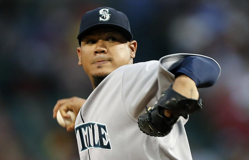 Seattle Mariners' Felix Hernandez pitches in the first inning of a baseball game against the Boston Red Sox in Boston, Thursday, Aug. 1, 2013. (AP Photo/Michael Dwyer)