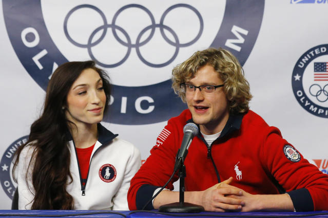 Ice dancing pair Meryl Davis (L) and Charlie White are introduced as part of the United States' team for the upcoming Sochi Winter Olympics, during a news conference at the U.S. Figure Skating Championships in Boston, Massachusetts January 12, 2014. REUTERS/Brian Snyder (UNITED STATES - Tags: SPORT FIGURE SKATING OLYMPICS)