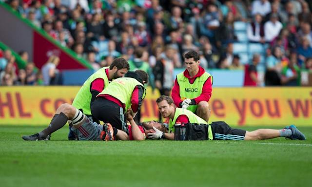 """<span class=""""element-image__caption"""">Chris Robshaw lies on the turf with a head injury and receives treatment.</span> <span class=""""element-image__credit"""">Photograph: Craig Mercer - CameraSport/CameraSport via Getty Images</span>"""