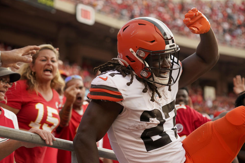 Cleveland Browns running back Kareem Hunt celebrates after scoring during the second half of an NFL football game against the Kansas City Chiefs Sunday, Sept. 12, 2021, in Kansas City, Mo. (AP Photo/Charlie Riedel)