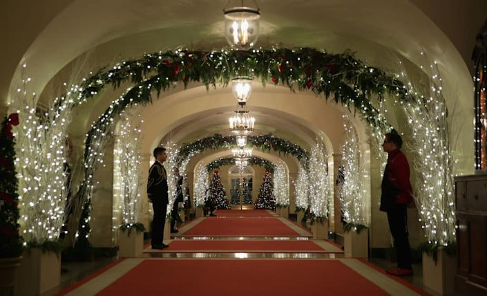 Holiday decorations are seen at a hallway of the White House December 3, 2014 in Washington, DC for the theme