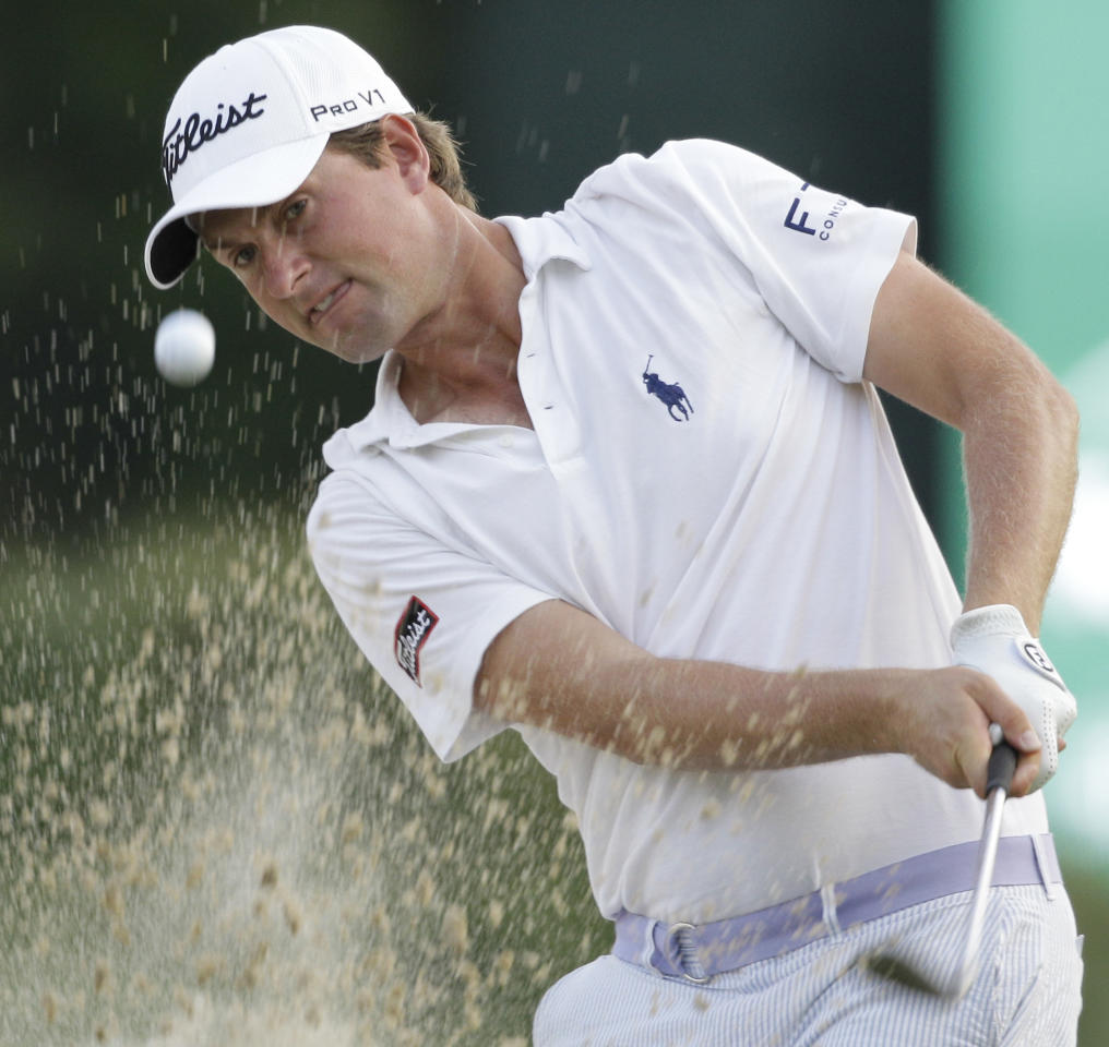 Webb Simpson watches his shot from a bunker on the 17th hole during the second round of the Greenbrier Classic PGA Golf tournament at the Greenbrier in White Sulphur Springs, W.Va., Friday, July 6, 2012. Simpson finished the day at 9 under par for the tournament. (AP Photo/Steve Helber)