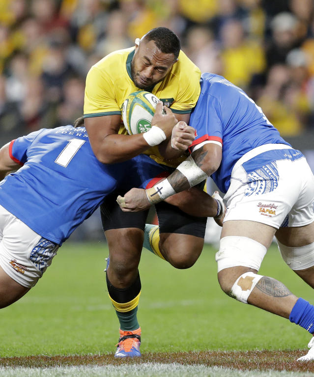 Australia's Sekope Kepu, center, is sandwiched by Samoa's Jordan Lay, left, and Afa Amosa during their rugby union test match in Sydney, Saturday, Sept. 7, 2019. (AP Photo/Rick Rycroft)