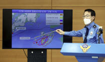 Yoon Seong-hyun, head of the Korea Coast Guard's investigation bureau, speaks during a briefing at the agency in Incheon, South Korea, Tuesday, Sept. 29, 2020. South Korea said Tuesday that a government official slain by North Korean sailors wanted to defect, concluding that the man, who had gambling debts, swam against unfavorable currents with the help of a life jacket and a floatation device and conveyed his intention of resettling in North Korea. (Yun Hyun-tae/Yonhap via AP)