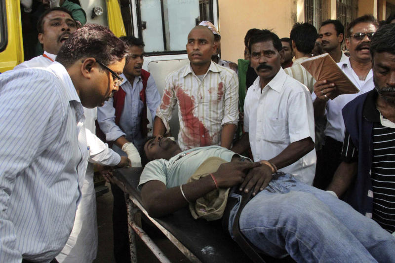 A man injured in bomb blasts is taken in a stretcher for treatment at the government medical college hospital in Patna, India, Sunday, Oct. 27, 2013. A series of small bomb blasts killed at least five people and injured dozens Sunday just hours before a massive campaign rally by the country's main opposition prime ministerial candidate Narendra Modi. (AP Photo/Aftab Alam Siddiqui)