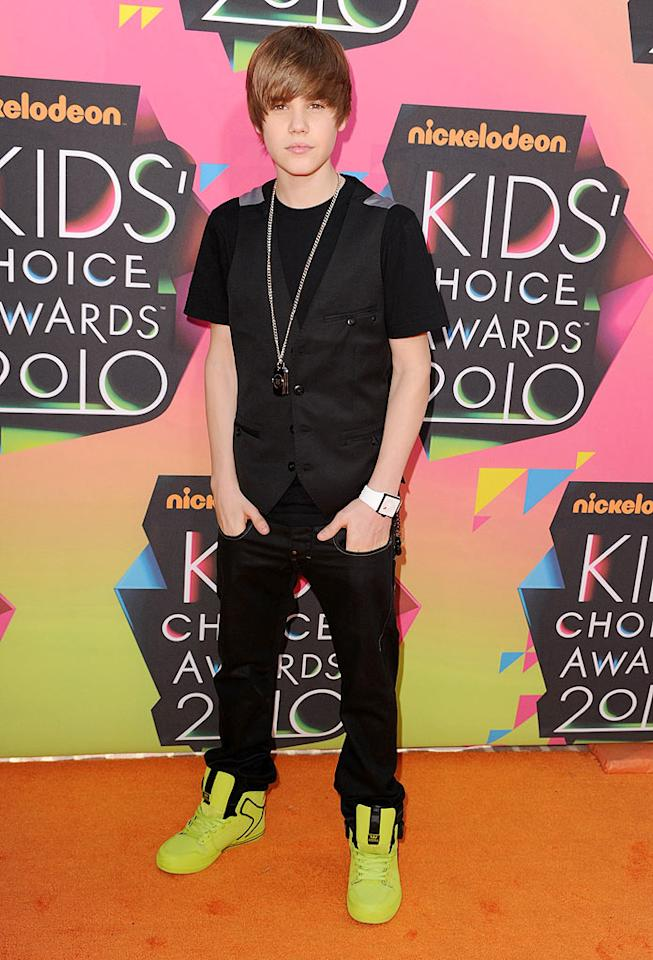 """Teen heartthrob Justin Bieber popped a pose in his signature 'do and loud sneakers upon arriving at the 23rd Annual Nickelodeon Kids' Choice Awards in Los Angeles, CA. Steve Granitz/<a href=""""http://www.wireimage.com"""" target=""""new"""">WireImage.com</a> - March 27, 2010"""