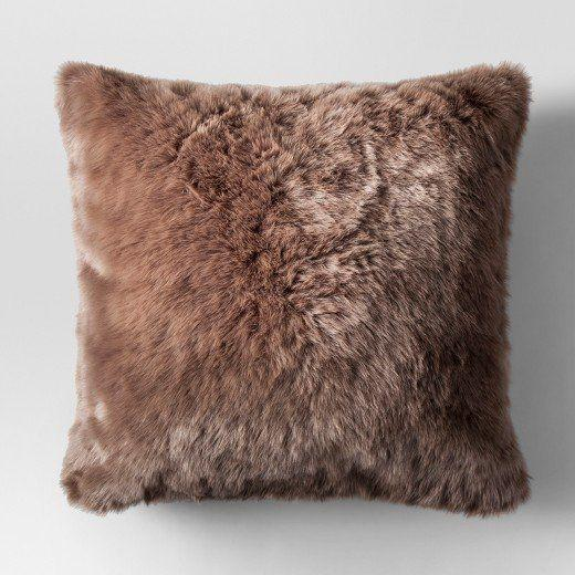 "Get it <a href=""https://www.target.com/p/faux-fur-oversized-throw-pillow-threshold-153/-/A-52968221#lnk=newtab"" target=""_blank"">here</a>."