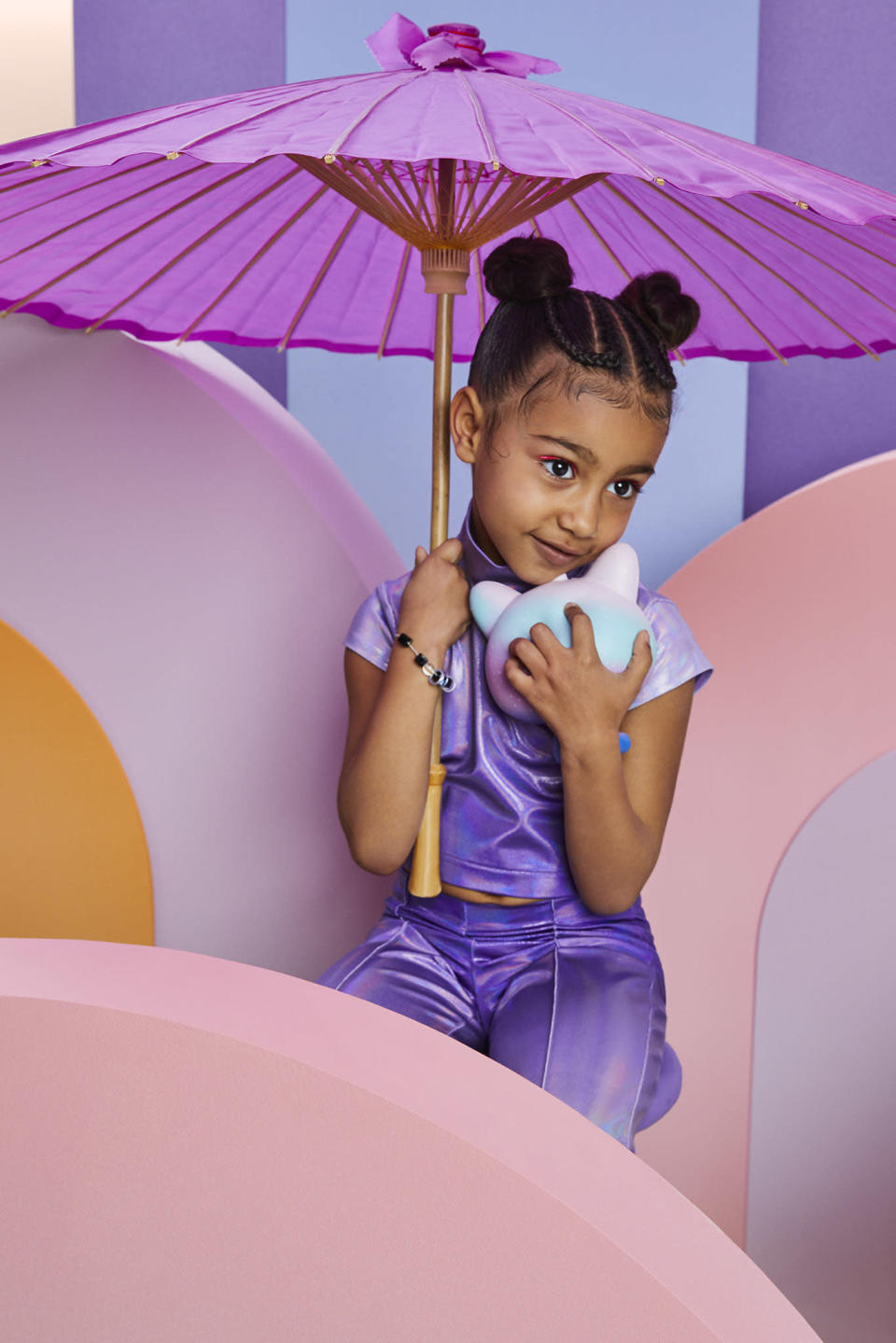 The 5-year-old is pictured with neon makeup to match her fashion. (Photo: JUCO for WWD)