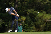 Dustin Johnson hits on the fifth fairway during the final round of the Masters golf tournament Sunday, Nov. 15, 2020, in Augusta, Ga. (AP Photo/David J. Phillip)