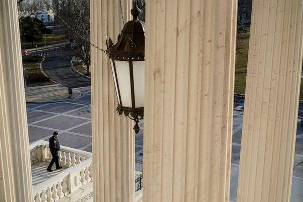 PHOTO: A member of the Capitol Hill police patrols at the U.S. Capitol after police warned that a militia group might try to attack the U.S. Capitol in Washington, D.C., March 4, 2021. (Joshua Roberts/Reuters)