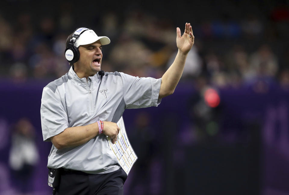 Troy head coach Neal Brown calls out from the sideline in the first half of the New Orleans Bowl NCAA college football game against North Texas in New Orleans, Saturday, Dec. 16, 2017. (AP Photo/Gerald Herbert)