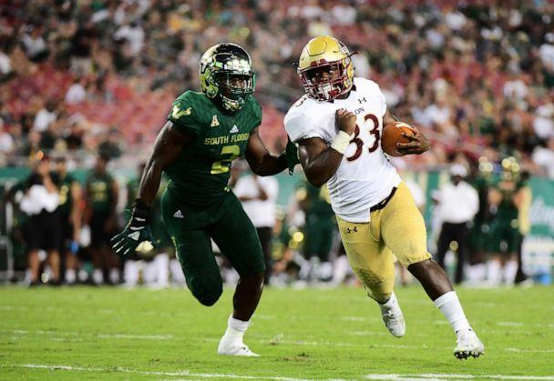 PHOTO: Elon Phoenix player rushes for a first down in the fourth quarter of a football game against the South Florida Bulls in Tampa, Fla (Julio Aguilar/Getty Images)
