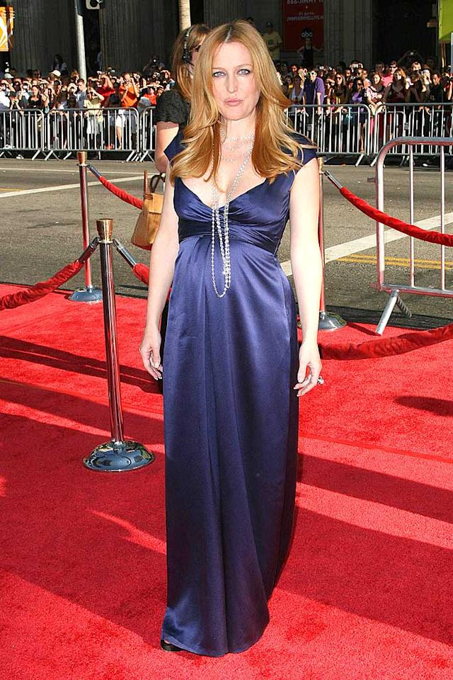 """A pregnant Gillian Anderson looks perfect upon arriving at """"The X-Files"""" premiere. Her tussled auburn tresses and blue gown are simply gorgeous. Entertainment Press/<a href=""""http://www.splashnewsonline.com"""" target=""""new"""">Splash News</a> - July 23, 2008"""