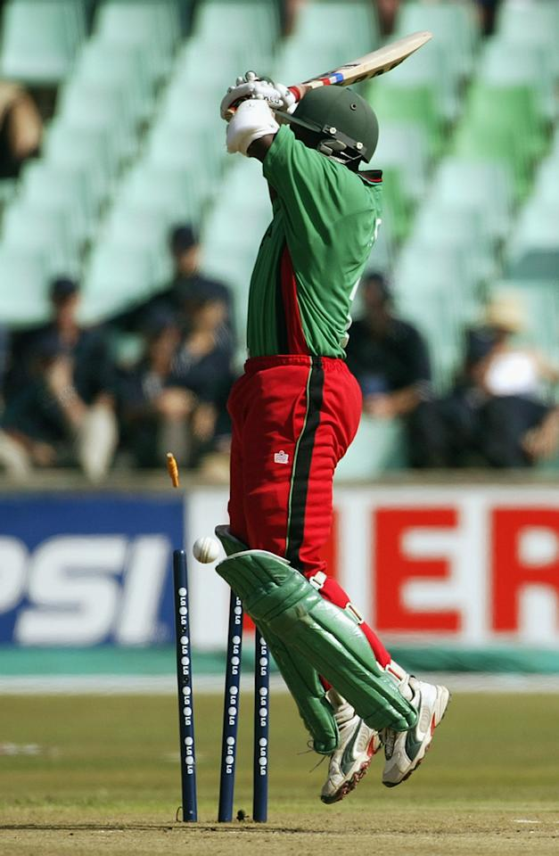 DURBAN- MARCH 15:  Kennedy Obuya of Kenya deflects the ball on to his wicket from a Brett Lee of Australia delivery during the World Cup Super Six One Day International match between Australia and Kenya held on March 15, 2003 played at Kingsmead, Durban, South Africa.  Australia won the match by 5 wickets. (Photo by Hamish Blair/Getty Images)
