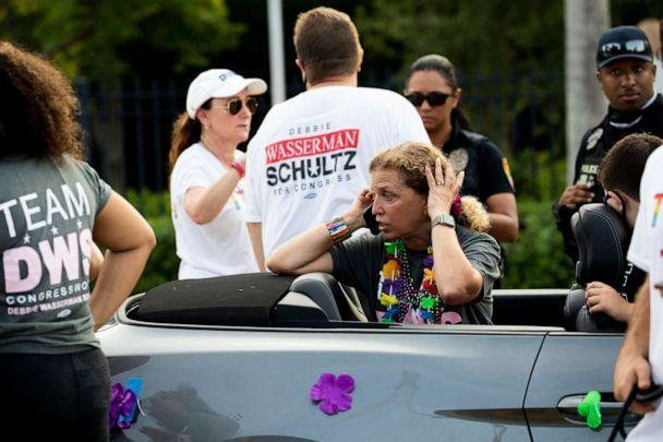 PHOTO: Rep. Debbie Wasserman Schultz, D-Fla., makes a call after a truck drove into a crowd of people during The Stonewall Pride Parade and Street Festival in Wilton Manors, Fla., Saturday, June 19, 2021.  (Chris Day/South Florida Sun-Sentinel via AP)