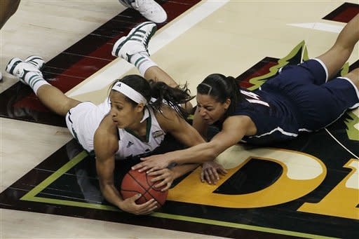Notre Dame guard Skylar Diggins (4) and Connecticut guard Bria Hartley (14) vie for a loose ball during the second half of the NCAA women's Final Four semifinal college basketball game, in Denver, Sunday, April 1, 2012. Notre Dame won 83-75. (AP Photo/David Zalubowski)