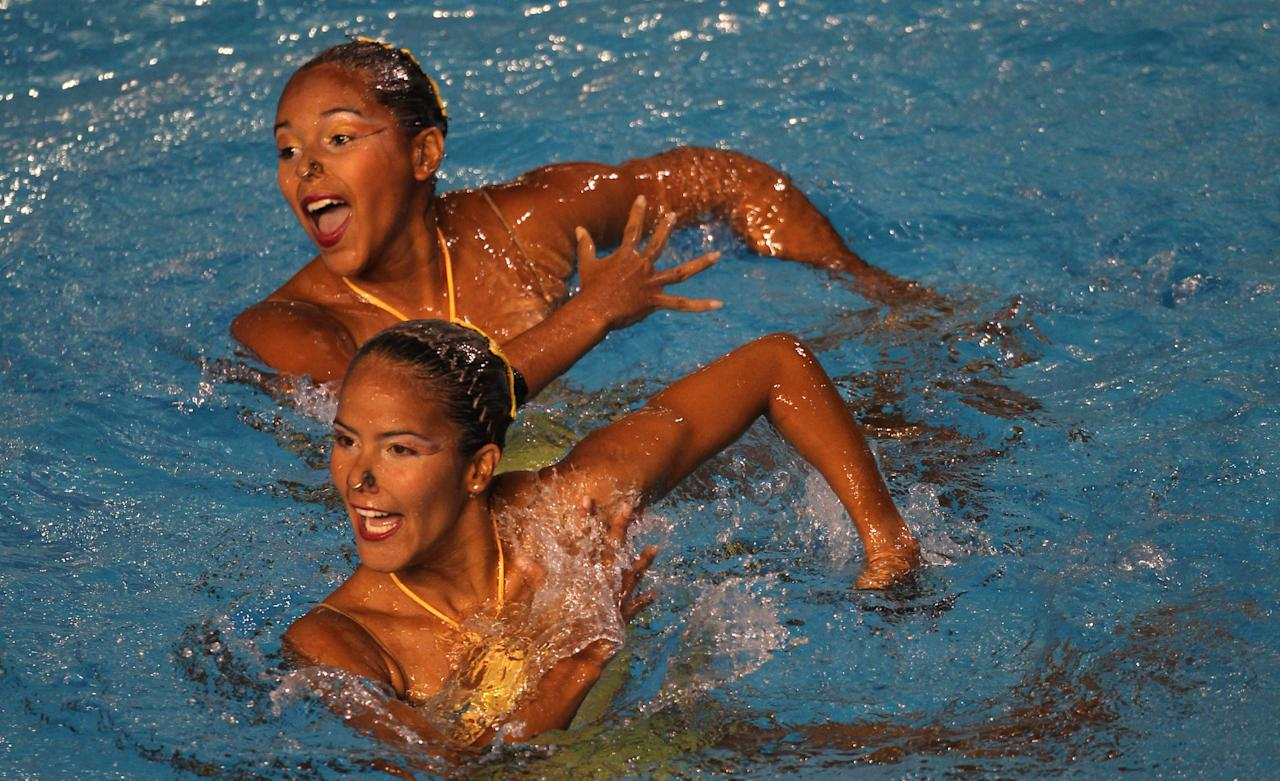 Venezuela's team perform a duet technical routine during the synchronized swimming preliminaries at the Pan American Games in Guadalajara, Mexico, Tuesday, Oct. 18, 2011. (AP Photo/Silvia Izquierdo)