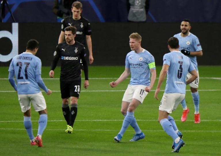 Kevin De Bruyne (centre) opened the scoring as Manchester City cruised into the Champions League quarter-finals