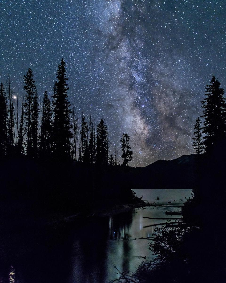 """<p>The Milky Way, constellations and shooting stars turn into the ultimate light show over the <a href=""""https://idahodarksky.org/"""" rel=""""nofollow noopener"""" target=""""_blank"""" data-ylk=""""slk:Central Idaho Dark Sky Reserve"""" class=""""link rapid-noclick-resp"""">Central Idaho Dark Sky Reserve</a>, a 1,400-square-mile territory near Sun Valley with some of the clearest night skies in the United States. Or venture to the north end of <a href=""""https://www.nps.gov/voya/learn/news/voyageurs-national-park-certified-as-international-dark-sky-park.htm"""" rel=""""nofollow noopener"""" target=""""_blank"""" data-ylk=""""slk:Voyagers National Park"""" class=""""link rapid-noclick-resp"""">Voyagers National Park</a> in International Falls, Minnesota, a 218,000-acre maze of lakes, forests, and islands. From this area, which got the International dark-sky certification in December 2020—you can see the dazzling aurora borealis displays, commonly known as the northern lights.</p>"""