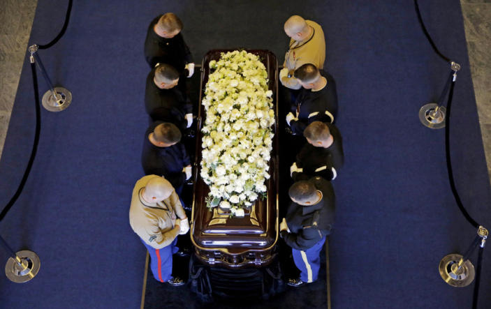 <p>Pallbearers pause for a moment before moving the casket of Nancy Reagan out of the public viewing area at the Ronald Reagan Presidential Library in Simi Valley, Calif., on Thursday. <i>(Photo: Jae C. Hong/ Pool/AP)</i></p>