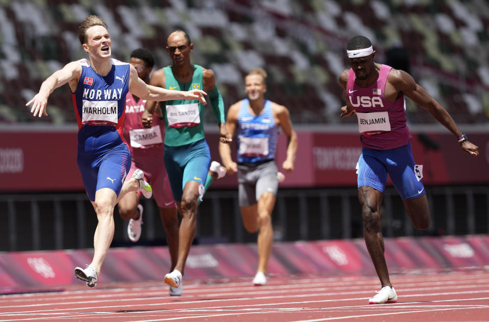 Karsten Warholm, of Norway celebrates as he wins the gold medal ahead of Rai Benjamin, of United States in the final of the men's 400-meter hurdles at the 2020 Summer Olympics, Tuesday, Aug. 3, 2021, in Tokyo, Japan. (AP Photo/Martin Meissner)