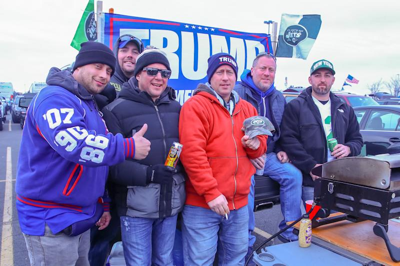 EAST RUTHERFORD, NJ - NOVEMBER 10: A group of fans with their Trump 2020 flag outside MetLife Stadium prior to the National Football League game between the New York Jets and the New York Giants on November 10, 2019 at MetLife Stadium in East Rutherford, NJ. (Photo by Rich Graessle/Icon Sportswire via Getty Images)