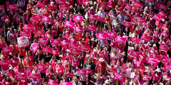 FILE - In this Wednesday, April 5, 2017 file photo, demonstrators participate in a rally for Planned Parenthood at the Capitol in Austin, Texas. Abortion advocates say Texas' capital of Austin has become the first city in the nation to provide funding toward logistical services for abortion access. (Jay Janner/Austin American-Statesman via AP, File)/Austin American-Statesman via AP)