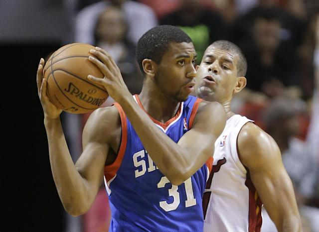 Philadelphia 76ers guard Hollis Thompson (31) looks for an opening past Miami Heat forward Shane Battier during the first half of an NBA basketball game on Wednesday, April 16, 2014, in Miami. (AP Photo/Wilfredo Lee)