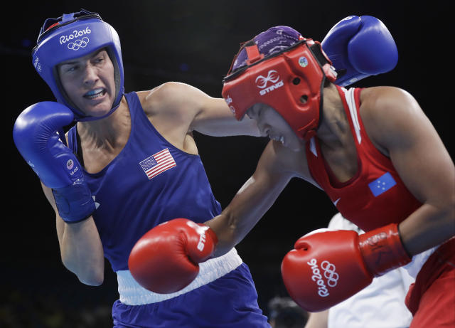 FILE - In this Friday, Aug. 12, 2016 file photo, United States' Mikaela Joslin Mayer, left, fights Micronesia's Jennifer Chieng during a women's lightweight 60-kg preliminary boxing match at the 2016 Summer Olympics in Rio de Janeiro, Brazil. U.S. Olympic boxer Mikaela Mayer announced her decision to pursue a professional career Friday, July 14, 2017 signing with promoter Top Rank. Her debut bout will occur in downtown Los Angeles on Aug. 5. (AP Photo/Frank Franklin II, File)