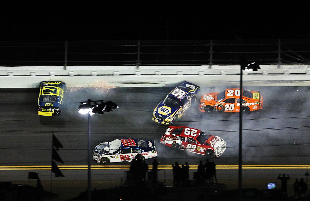 DAYTONA BEACH, FL - FEBRUARY 18:  Matt Kenseth, driver of the #17 Best Buy Ford, Dale Earnhardt Jr., driver of the #88 Diet Mountain Dew/National Guard Chevrolet, Martin Truex Jr., driver of the #56 NAPA Auto Parts Toyota, Joey Logano, driver of the #20 The Home Depot Toyota, and Kevin Harvick, driver of the #29 Budweiser Chevrolet, crash during the NASCAR Budweiser Shootout at Daytona International Speedway on February 18, 2012 in Daytona Beach, Florida.  (Photo by Jamie Squire/Getty Images)
