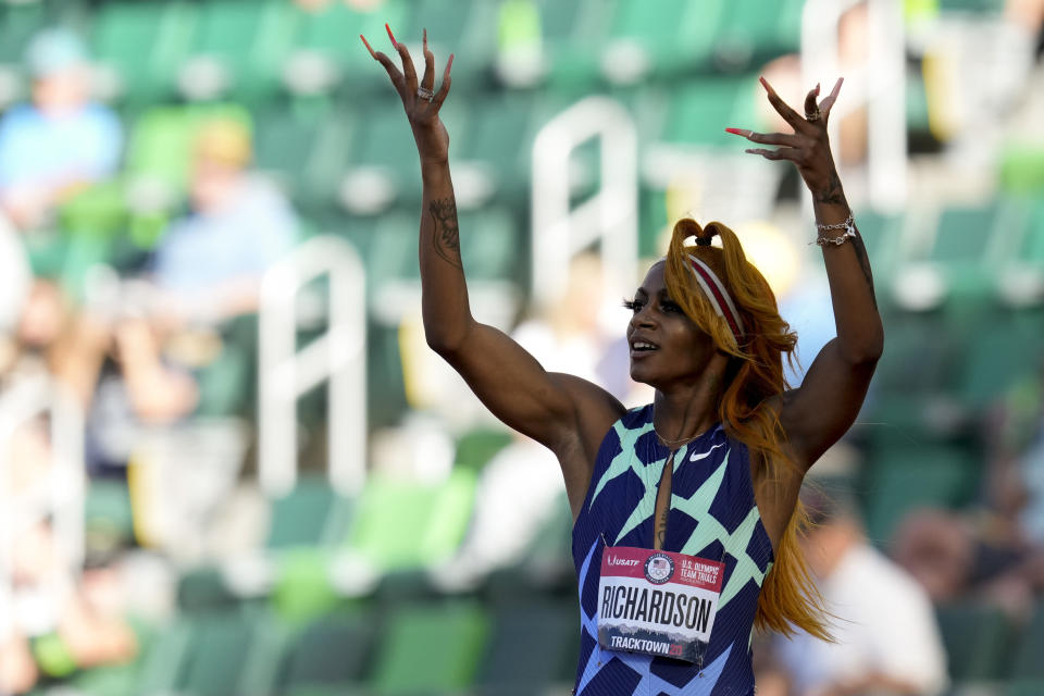 Sha'Carri Richardson celebrates after winning the first heat of the semi finals in women's 100-meter runat the U.S. Olympic Track and Field Trials Saturday, June 19, 2021, in Eugene, Ore. (AP Photo/Ashley Landis)