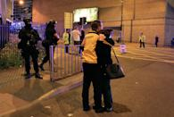 """<p>Armed police stand guard at Manchester Arena after reports of an explosion at the venue during an Ariana Grande gig in Manchester, England Monday, May 22, 2017. Police says there are """"a number of fatalities"""" after reports of an explosion at an Ariana Grande concert in northern England. (Peter Byrne/PA via AP) </p>"""