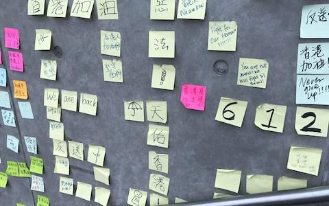 The sticky notes recreate the democracy wall that started during the 2014 protests  - Credit: Sophia Yan