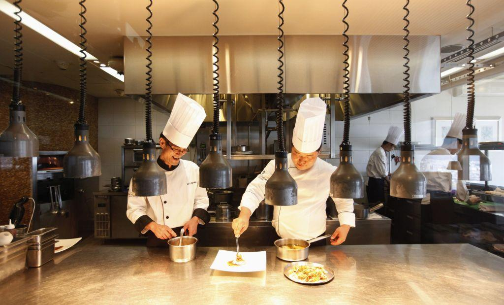 Chefs prepare a dish at the Marco Polo restaurant at the Grand Intercontinental Hotel in the Gangnam area of Seoul.