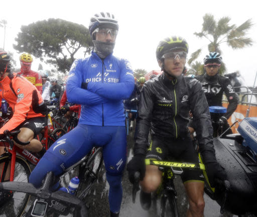Elia Viviani of Italy, left, and Simon Yates of Great-Britain, wait the start of the eighth stage of the Paris Nice cycling race starting and finishing in Nice, southeastern France, Sunday, March 11, 2018. (AP Photo/Claude Paris)