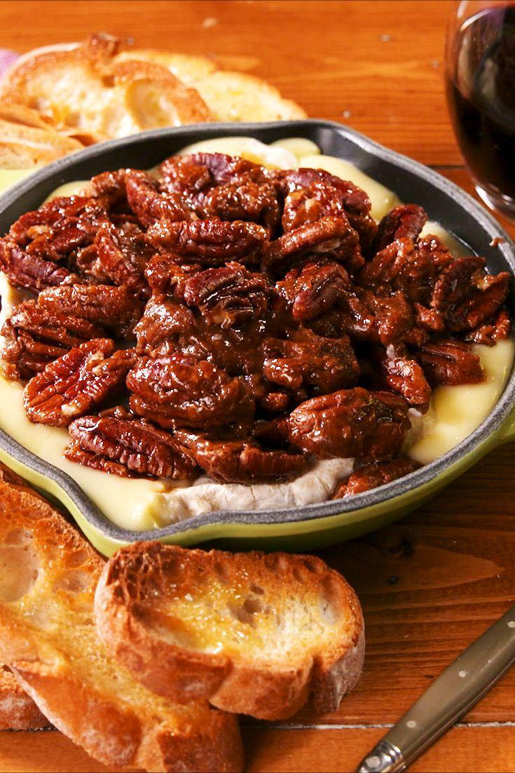 """<p>You can never go wrong with a brie appetizer...especially when it's covered in cinnamon-sugar pecans.</p><p>Get the recipe from <a href=""""https://www.delish.com/holiday-recipes/thanksgiving/a24851390/pecan-pie-brie-recipe/"""" rel=""""nofollow noopener"""" target=""""_blank"""" data-ylk=""""slk:Delish"""" class=""""link rapid-noclick-resp"""">Delish</a>. </p>"""