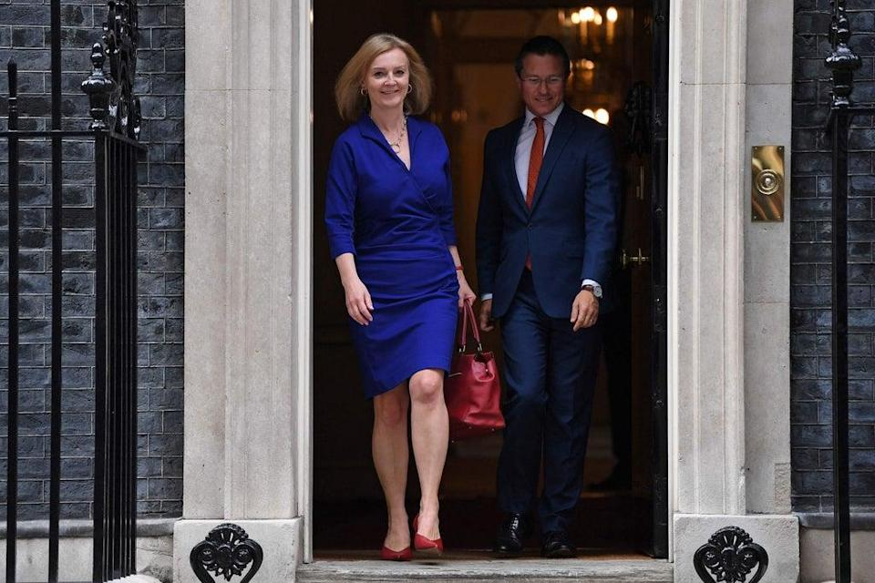 Liz Truss was all smiles as she left 10 Downing Street after being made Foreign Secretary (AFP via Getty Images)