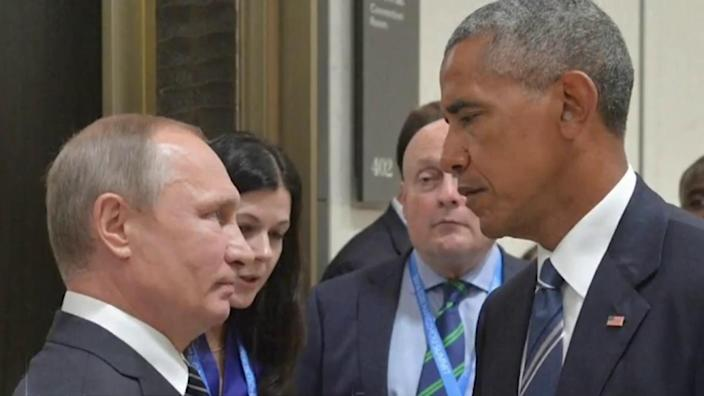 Who blinks first? Presidents Putin and Obama stare at each other in a meeting in China (Getty)