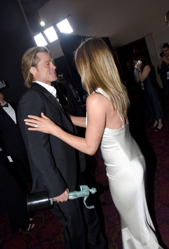 """<p>This SAG Awards moment makes clear Jennifer still cares about Brad, but it's not like she's making moves to get him back or anything, says Donaldson. </p><p>""""She touches him in a neutral area—the shoulders—which tells us the touch is not romantic,"""" Donaldson explains. What is worth noting though, is Jennifer's double-handed touch. It means her attention (even though you can't see her face) is 100 percent on this moment with Brad.<br></p>"""