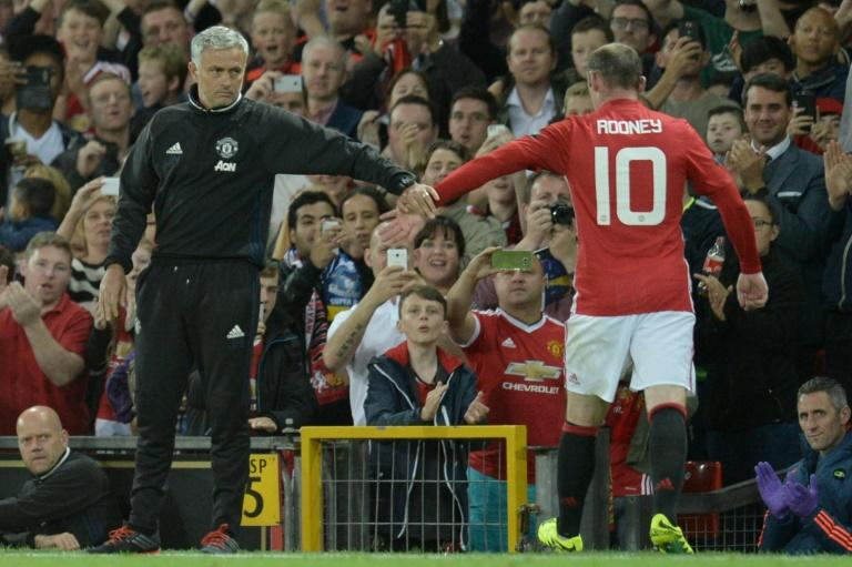 Manchester United's Jose Mourinho (left) acknowledges Wayne Rooney as the striker is substituted during a friendly testimonial against Everton at Old Trafford on August 3, 2016