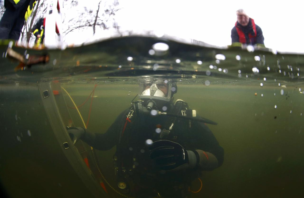 Martin Weitzendoerfer, diver of Frankfurt's firefighter rescue brigade, leaves a frozen lake during a rescue exercise in Frankfurt, Germany, January 24, 2017.    REUTERS/Kai Pfaffenbach      TPX IMAGES OF THE DAY