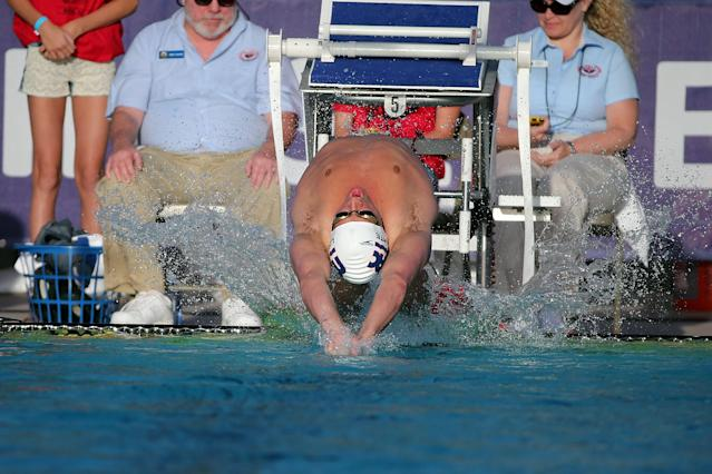 MESA, AZ - APRIL 15: Ryan Lochte launches off the blocks at the start of the men's 100 meter backstroke final at the Skyline Aquatic Center on April 15, 2016 in Mesa, Arizona. (Photo by Chris Coduto/Getty Images)